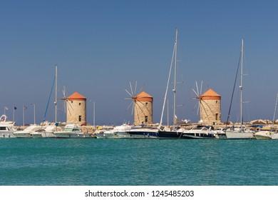 three historic windmills at the Mandraki-Port in Rhodes