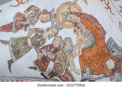 the three holy kings bring gold, frankincense and myrrh to Jesus, a wall-painting from about the year 1500 in the church of St. Mary, Elsinore, Denmark, May 14, 2019