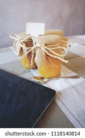 Three honey jars  in a table