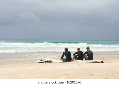 Three hopeful guys waiting for the surf to pick up