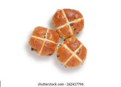 Three hot cross buns shot from above, isolated on white with clipping path