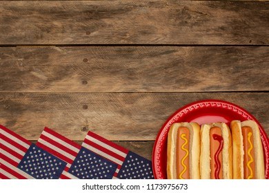 Three hot dogs on a red plate mustard ketchup background with copy space