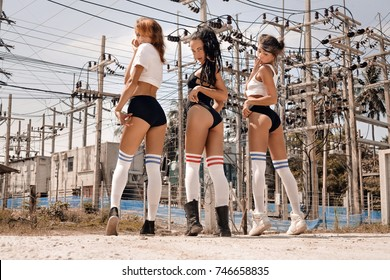 three hot young girls hip-hop dancers outdoors