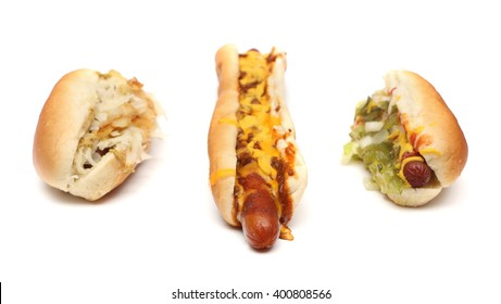 Three hotdogs in a row on a white background