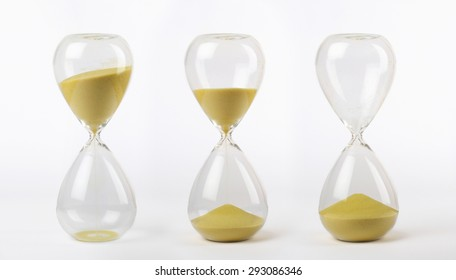 three hourglasses with yellow sand: from start to the end on white background