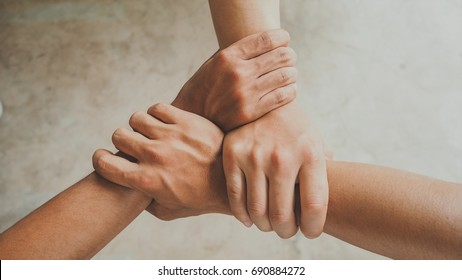 Three human join hands together background, collaboration of business and education teamwork concept