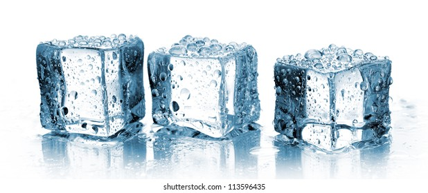 three ice cubes in row on white