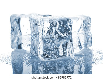 Three ice cubes with water drops isolated on white background