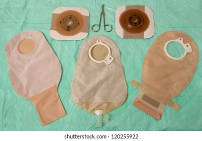 THree ileostomy bags of differing types with barrier rings and scissors