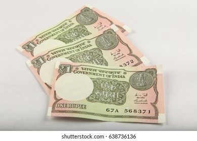 Three Indian currency One rupee notes