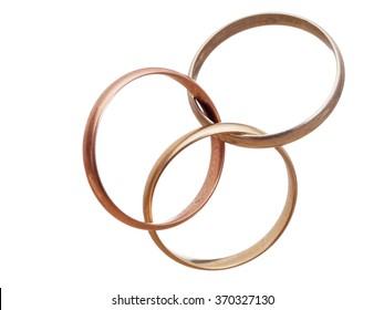 Three interlocking wedding rings. Modern marriage? Bigamy? Concept. Isolated on white.