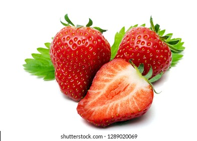 Three isolated strawberries in front of white