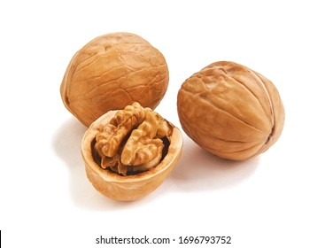 Three isolated wallnuts, one with half-open nutshell and brain-like kernel, white background