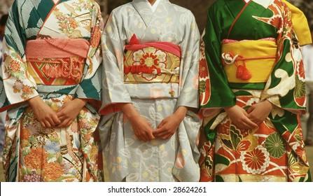 Three Japanese women and their kimonos