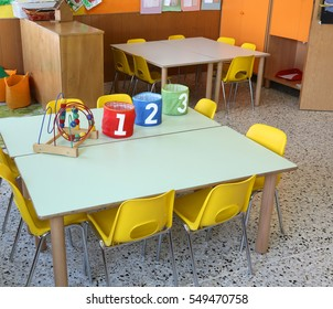 Three jar with writing 1 2 3 into a kindergarten classroom without children