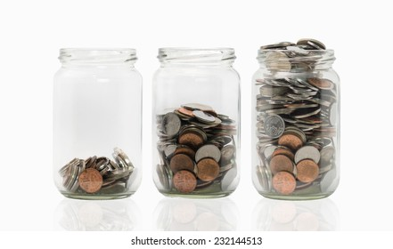 Three jars with different level of coins.