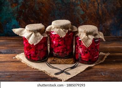 Three jars of pickled beetroot and cauliflour