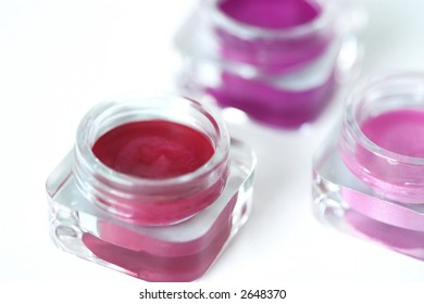 three jars of pink and red lip gloss - lipstick