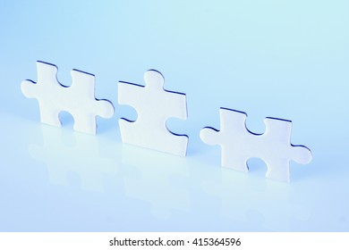 Three jigsaw puzzle pieces