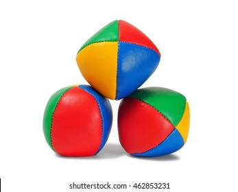 Three juggling balls on white background