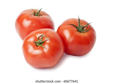 Three juicy, red tomatoes isolated on white background. / Three tomatoes