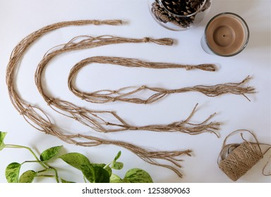 Three jute twine macrames displayed beside various props. They are made from 100 percent natural jute fibers.