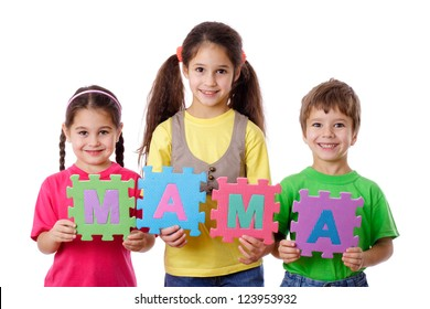 Three kids with colorful letters displays the word Mom, isolated on white