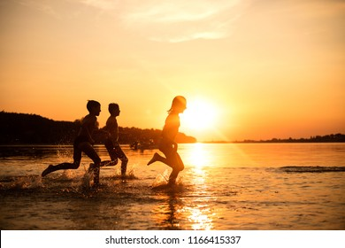 Three Kids having fun outdoors. Concept of summer vacation and friendly family