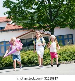Three kids having fun at school