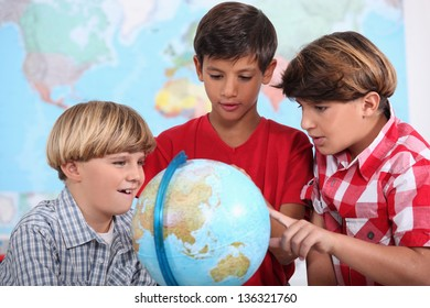 Three kids learning geography.