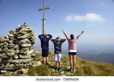 Three kids on the top of a mountain