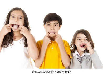 three kids playing, making a grimace