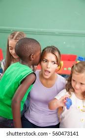 three kids and teacher in  Kindergarten