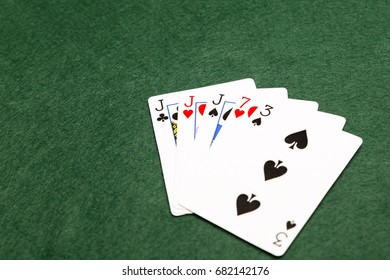 Three of a kind, the seventh highest hand in poker.Three cards of the same value supported by any other two cards