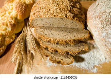 three kinds of fresh, well smelled bread and a wheat