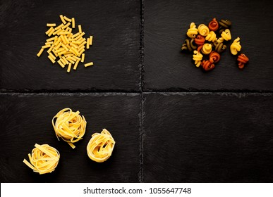Three kinds of pasta, on black slate base with one section free for graphics, and or text.