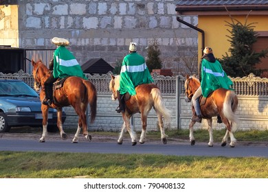 Three Kings carolling on horses - young men acting a Christmas Nativity scene on a Three Kings Day in accordance with Polish local tradition.