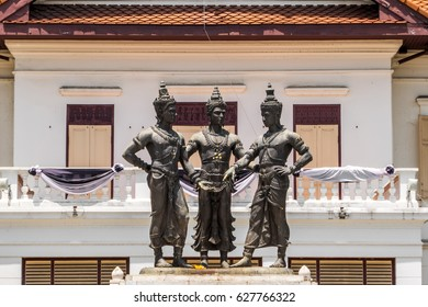 The three kings monument with the nice building background in Chiang Mai province of Thailand. This is a public area and can take picture for sale.