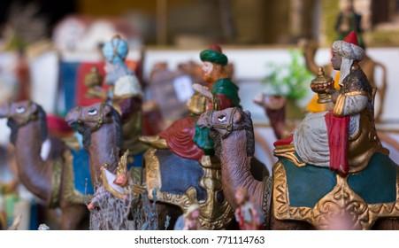 Three Kings Nativity Set on camels. Street market Christmas concept
