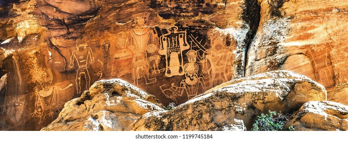 """""""Three Kings Panel,"""" a collection of Fremont Indian anthropomorph petroglyphs, sometimes described as ancient aliens or astronauts, Mcconckie Ranch in Dry Fork Canyon outside of Vernal, Utah, USA."""