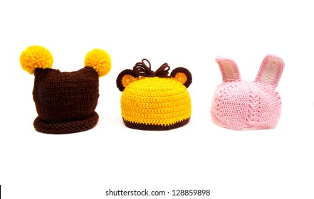 Three knitted hats for newborns isolated on white background