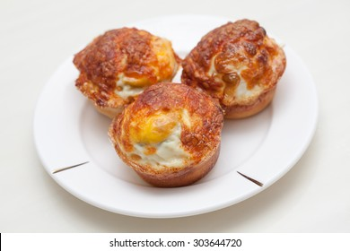 Three Korean Style Egg Cupcake of in a white plate.