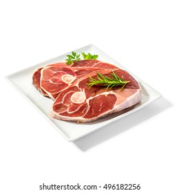 Three lamb slices on plate with spice herbs, isolated