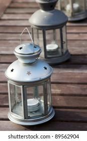 Three lanterns on a wooden table