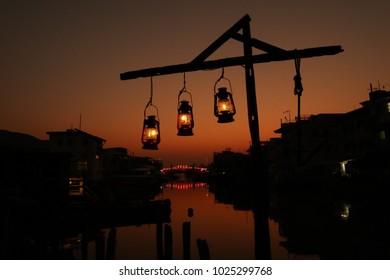 Three Lanterns at Orange Sunset