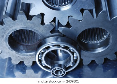 three large gears and ball-bearings connecting in blue