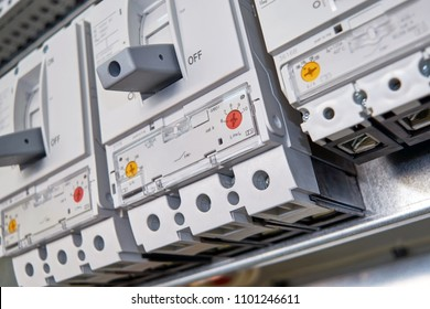 Three large, modern, powerful circuit breakers in the electrical Cabinet. Reliable protection and distribution of electrical energy in production, industry. Power supply of buildings and facilities.