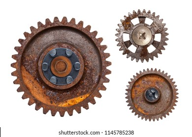 Three large rusty metal gears isolated on a white background.