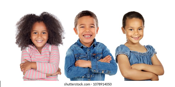 Three latin children crossing their arms isolated on a white background