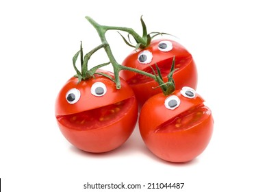 Three laughing tomatoes isolated on white background